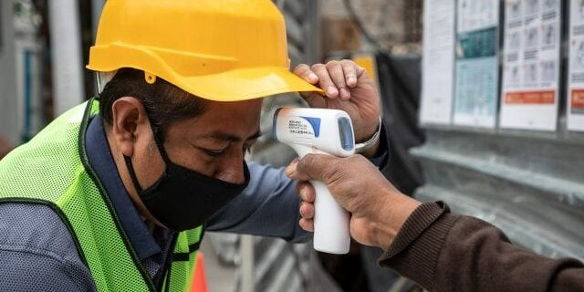 measuring covid19 temperature at construction site - safety management software